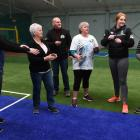 Walking netballers (from left) Nic Smith (33), Beverley McLay (71), Dayna Dixon (45), Maddy Dixon (18) and Lyn Dixon (72) get in some practice at Metro Indoor Sports earlier this week. Metro's managing director, Bryan McIntyre, is ready with the whistle.