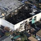 Firefighters work inside the burned warehouse following the fatal fire in the Fruitvale district of Oakland. Photo: Reuters