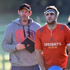 New Otago assistant coach Tom Donnelly, alongside Highlanders loose forward Luke Whitelock, at training at Logan Park last week.Photo: Peter McIntosh