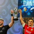 All Black captain Kieran Read (left) and Lions captain Sam Warburton jointly hoist the winner's...