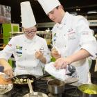 Otago Polytechnic Central Campus chefs Freda Zhang (left) and Sam Farr cook their way to a silver...