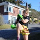 Muay Thai specialist Sue Glassey kicks and jabs outside her Roxburgh home. Photo: Jono Edwards