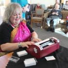 """""""That Blind Woman'' Julie Woods types a Holmdene resident's name in Braille as part of a new..."""