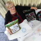 Creative Arts Centre president Mearle Wilson shows off her specially embroidered quilt which will...