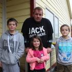 Brodie Cook  with his three children (from left) Memphis (11), Indiana (6) and Phoenix (8)...
