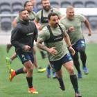 Highlanders hooker Ash Dixon, with first five-eighth Lima Sopoaga behind him, training at Forsyth...