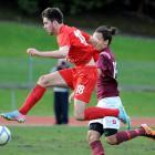 Caversham striker Tore Waechter (left) gets the jump on Dunedin Technical's Logan Mamanu during...