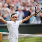 Switzerland's Roger Federer celebrates winning the semi final match against Czech Republic's...