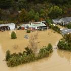 Residents need to take all cautions and remain away from properties inundated at present. Photo:...