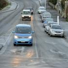 Vehicles travel slowly in Warrender St in North Dunedin yesterday.
