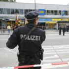 A police officer looks on after a knife attack in a supermarket in Hamburg. Photo: Reuters