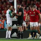 All Black captain Kieran Read remonstrates with referee Romain Poite after Poite awarded a scrum...