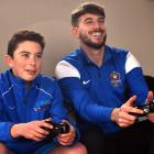 Playing Fifa 17 are Rory Hibbert (12) and Southern United player Conor O'Keefe, who has featured...