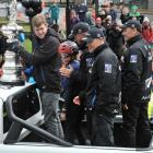 William Bary (10) gets on board with Team New Zealand at the America's Cup parade in Dunedin...