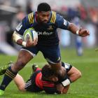 Waisake Naholo of the Highlanders is tackled by David Havili of the Crusaders in a match earlier...