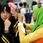 Muslim cosplayers prepare for a cosplay event. Photo: Reuters