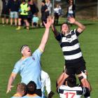 Southern loose forward and Pirates refugee Josh Clark (right) is hoisted in a lineout during his...