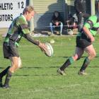 Maheno first five Chris Jennings restarts play next to team-mate Kieran Byrne during the Citizens...