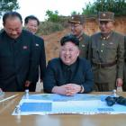 North Korean leader Kim Jong Un reacts during the long-range strategic ballistic rocket Hwasong...