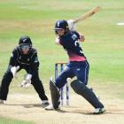 Nat Sciver prepares to play a cut shot for England as White Ferns keeper Rachel Priest looks on....