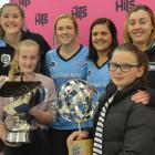 Emily Templeton (11), of Alexandra, and Peyton Robertson (11), of Clyde, hold the ANZ Premiership...
