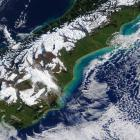 A satellite image clearly shows the sediment run-off from flooding along Otago's coast. Photo:...