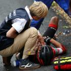 Richie Porte of Australia riding for BMC Racing Team is attended to by medical staff after...