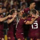 Queensland players celebrate a Jarrod Wallace try during their win in State of Origin III last...