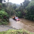 Rescuers battled rising floodwaters to reach the man. Photo: NZ Police
