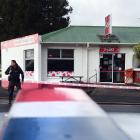 Police at the scene of an attempted robbery of the Halfway Bush Convenience Store at the...