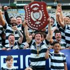 Southern Captain Josh Walden holds aloft the Speights Championship Shield after his side beat...
