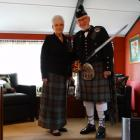 Sheila and Todd wall clad in their highland gear in their Brighton home. PHOTO: JOSHUA RIDDIFORD