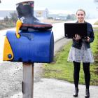 TracMap marketing intern Georgia Ellis with Welly the gumboot, which is seeking rides the length...