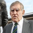 Sir Colin Meads in front of the statue of himself in June in Te Kuiti. Photo: NZ Herald.