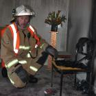 Alexandra Chief Fire Officer Russell Anderson inspects the scene of a suspected arson at...