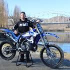 Circus motocross rider Regan Hunter, of Alexandra, displays his trusty bike by the Clutha River....