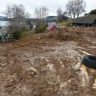 Clean-up work has began at Gordon Sasse's Blanket Bay Rd home, after the property was swamped by...