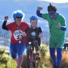 Caleb Constable (9) is chased by Blue Light Dash supporters Steve Morgan (right) and Janine...