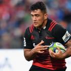 Codie Taylor carries the ball for the Crusaders. Photo: Getty Images