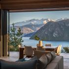 The covered outdoor room faces the lake but can be sheltered from the wind by stacking doors that...