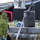 "Police technicians investigate the rescued private submarine ""UC3 Nautilus"" in Copenhagen. Photo:..."