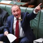 Australia's Deputy Prime Minister Barnaby Joyce gestures during question time at Parliament House...