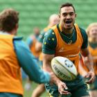 Rory Arnold offloads the ball during a Wallabies Captain's Run at AAMI Park in Melbourne in June....