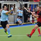 Seeking to control the ball are Blue Whales player Kieran O'Connor (left) and Albany's Matt Moore...