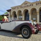 Ophir postmistress Val Butcher takes a ride in a now sold 1934 Bugatti Type 57 Gangloff Roadster,...