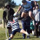Kings High School centre Giovanni Leituala leaps over Otago Boys High School fullback Isaak Te...