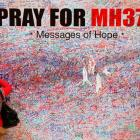 A woman leaves message of support and hope for passengers of missing Malaysia Airlines MH370 in...