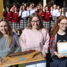 Dunstan High School Senior Girls' Choir members (from left) Holly Taucher (18) Molly Ellis (17)...