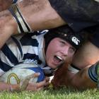 Otago Boys' High School lock Anton Schroder looks up to celebrate after scoring a try against...
