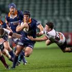 Teihorangi Walden of Otago is tackled during the round one Mitre 10 Cup match between North...